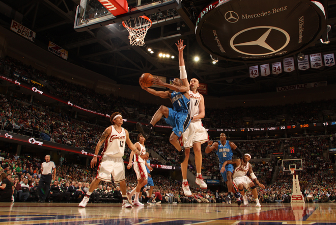 Orlando Magic guard Rafer Alston shoots a layup as Cleveland Cavaliers center Zydrunas Ilgauskas tries to block it from behind in Cleveland's 97-93 win on March 17th, 2009.