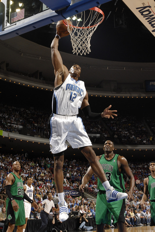 Dwight Howard of the Orlando Magic throws down a one-handed slam dunk in an NBA Basketball game against the Boston Celtics in Amway Arena on Wednesday, March 25th, 2009