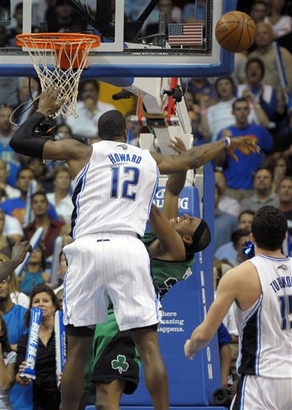 Dwight Howard of the Orlando Magic blocks the shot of Paul Pierce of the Boston Celtics late in the fourth quarter of Orlando's 84-82 win over Boston on Wednesday, March 25th, 2009