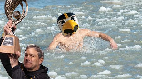 Kirk-ferentz-in-cold-water-with-iowas-mascot_medium
