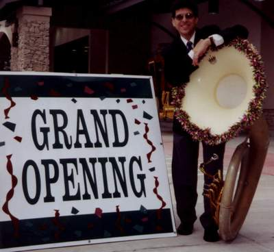 Randall_27s_20ken_20with_20_20grand_20opening_20sign_medium
