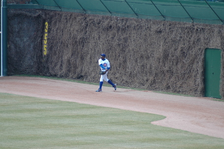 Alfonso Soriano throws in after overrunning Miguel Tejada's triple