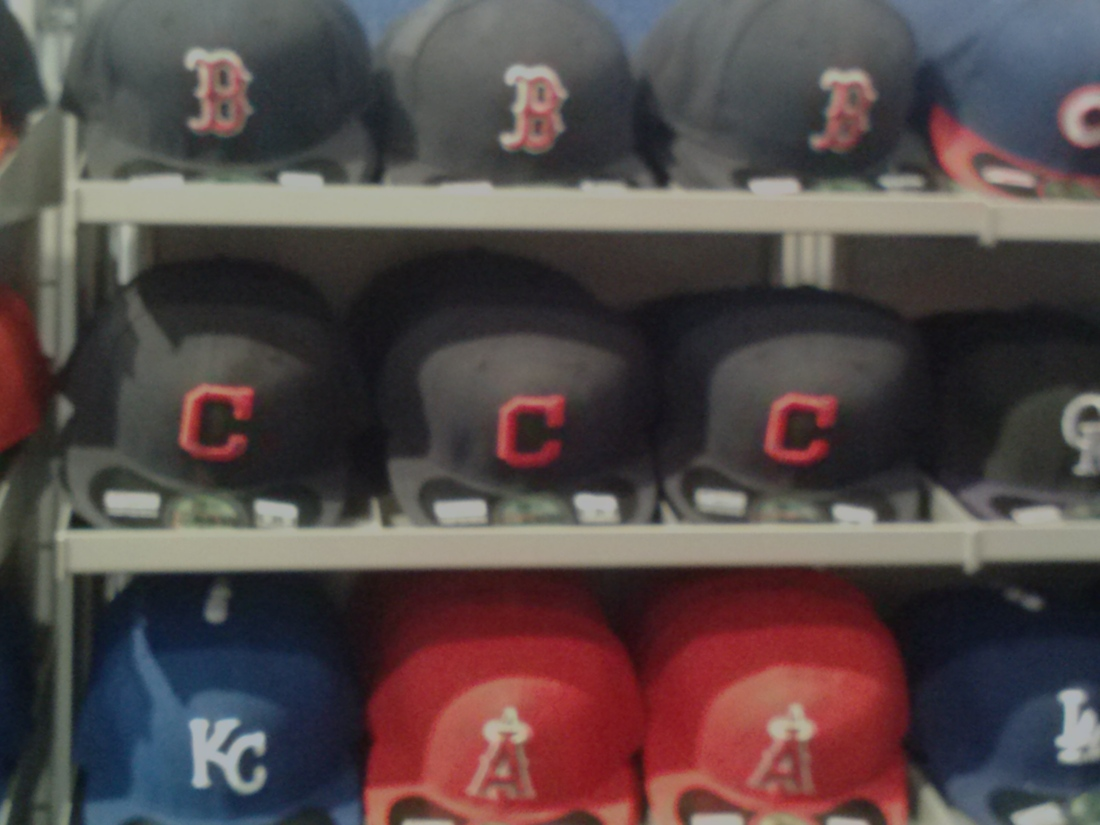 8af23bed1d Neyer visited both cap displays at the MLB Clubhouse store. Both of them  featured the Indians  block-C caps (red and ...
