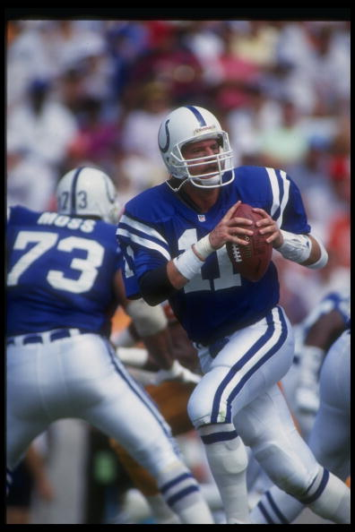 "The secret behind QB Jeff George's incredible arm strength: he always kept his index finger on top of the football's noseThis allowed him to give the ball a direct ""push"" from behind just as it was leaving his hand.   It's not something you often see from QBs as it creates an awkward grip, requires larger hands, and can mess with accuracy.   Examples...  https://assets.sbnation.com/assets/589361/jgeorge1_medium.jpg  https://cdn-s3.si.com/s3fs-public/si/multimedia/photo_gallery/0906/nfl.number.one.qb.as.rookies/images/jeff-george.jpg  http://static.nfl.com/static/content/public/image/getty/2008/09000d5d807cb253_gallery_600.jpg"